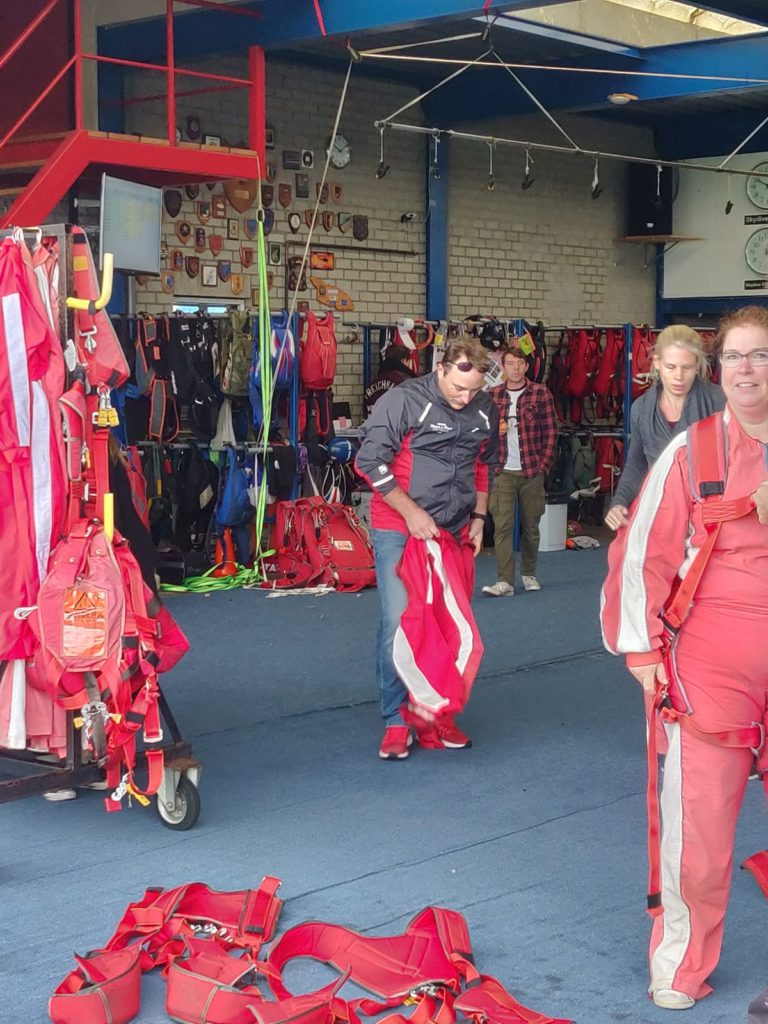 Prepare for Tandem parachute jump